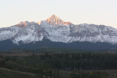 sunrise lights up the tip of Wilson Peak- 14,017 ft., as seen from Last Dollar Ranch- Telluride