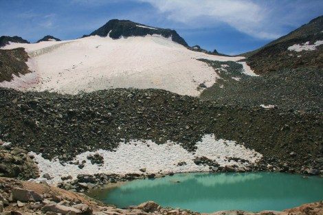 Mt. Lyell and the Lyell Glacier (2nd largest in the Sierra Nevada) looms above a turquoise melt pond