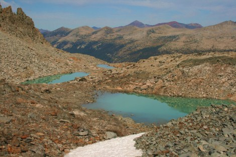 turquoise melt ponds at the base of Mt. Lyell