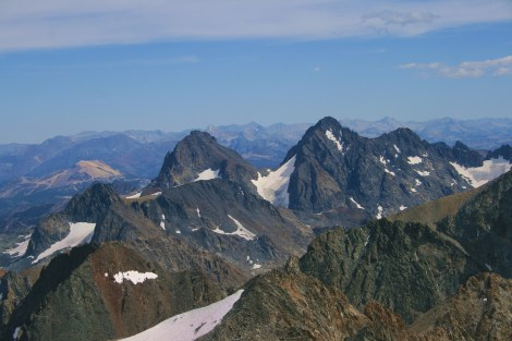 view south to the twin ears of Banner Peak (left) and Mt. Ritter in the Ansel Adams Wilderness. Mammoth Mountain ski resort is the tan dome at left. As seen from the summit of Mt. Lyell