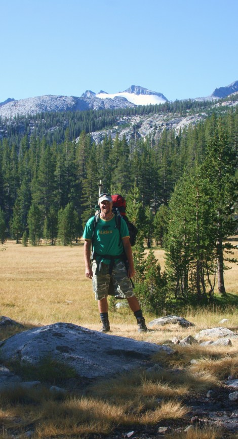me in the Lyell Meadows, with Mt. Lyell looming in distance.