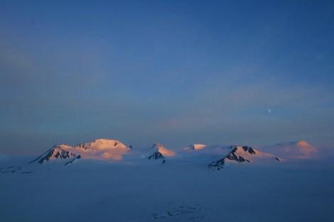 the Grand Dandini and surrounding nunataks catching the last dying rays of sunlight- Harding Icefield