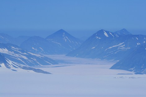 Tustamena Glacier fills an entire valley as it flows off the Harding Icefield