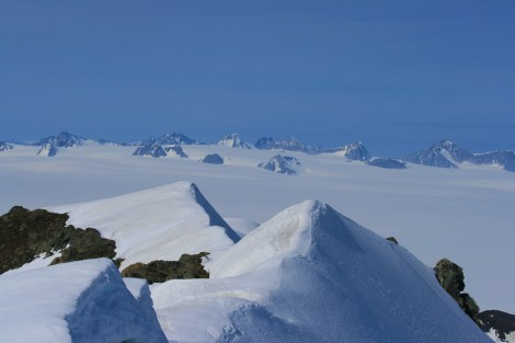 view to other remote nunataks poking out of the Harding Icefield, from the summit of the Dandini