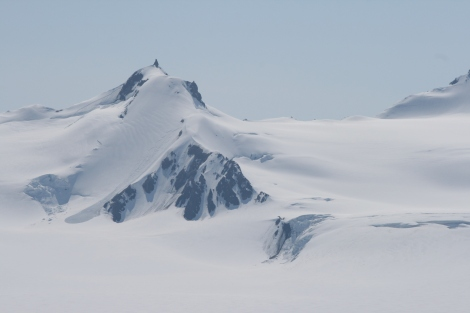 """the """"Stinger"""" rises up out of the icefield, as seen from camp"""