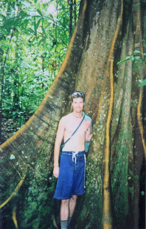 me alongside a large tree in the Corcovado rainforest