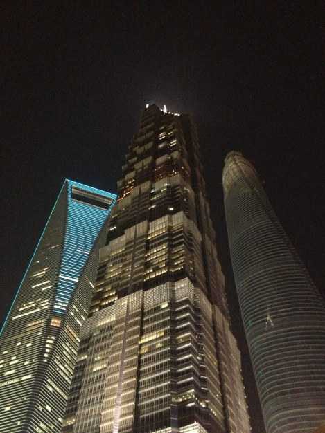 Shanghai World Financial Tower (left), Jin Mao (center) and Shanghai Tower at night- three of the world's  tallest buildings