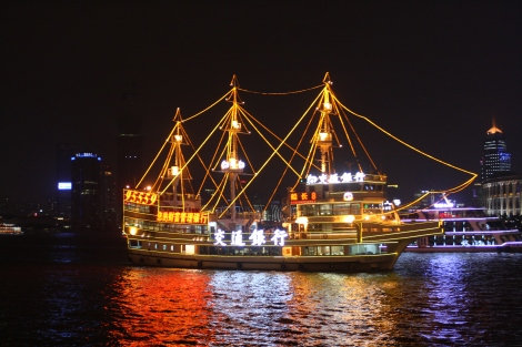pirate ship sailing the Huangpu River at night