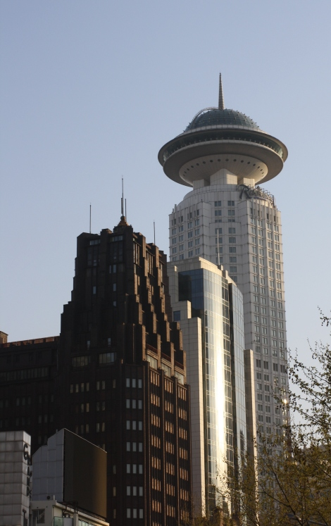 the Park Hotel (left)- 275 feet, was the tallest building in Shanghai for over 50 years until 1983. The Radisson towers over it now