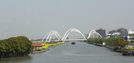 a twisting, funky looking bridge on the outskirts of Zhujiajiao