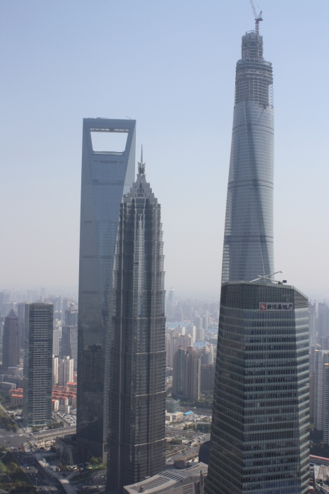 view to the Shanghai Financial Center- the bottle opener; the Jin Mao Tower (center) and Shanghai Tower (under construction- soon to be the world's 2nd highest building), from the Pearl