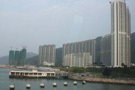 first view of Hong Kong skyscrapers, from the train leaving the airport. Note the new buildings being constructed...